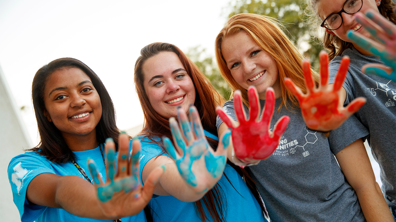 Students with paint on their hands from the LC Welcome celebration