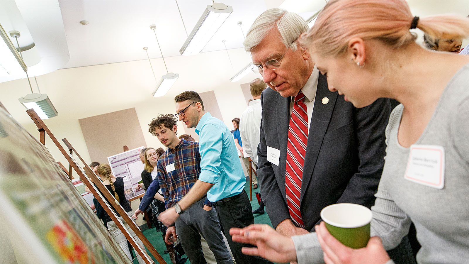 Students and mentors at a UCARE poster event